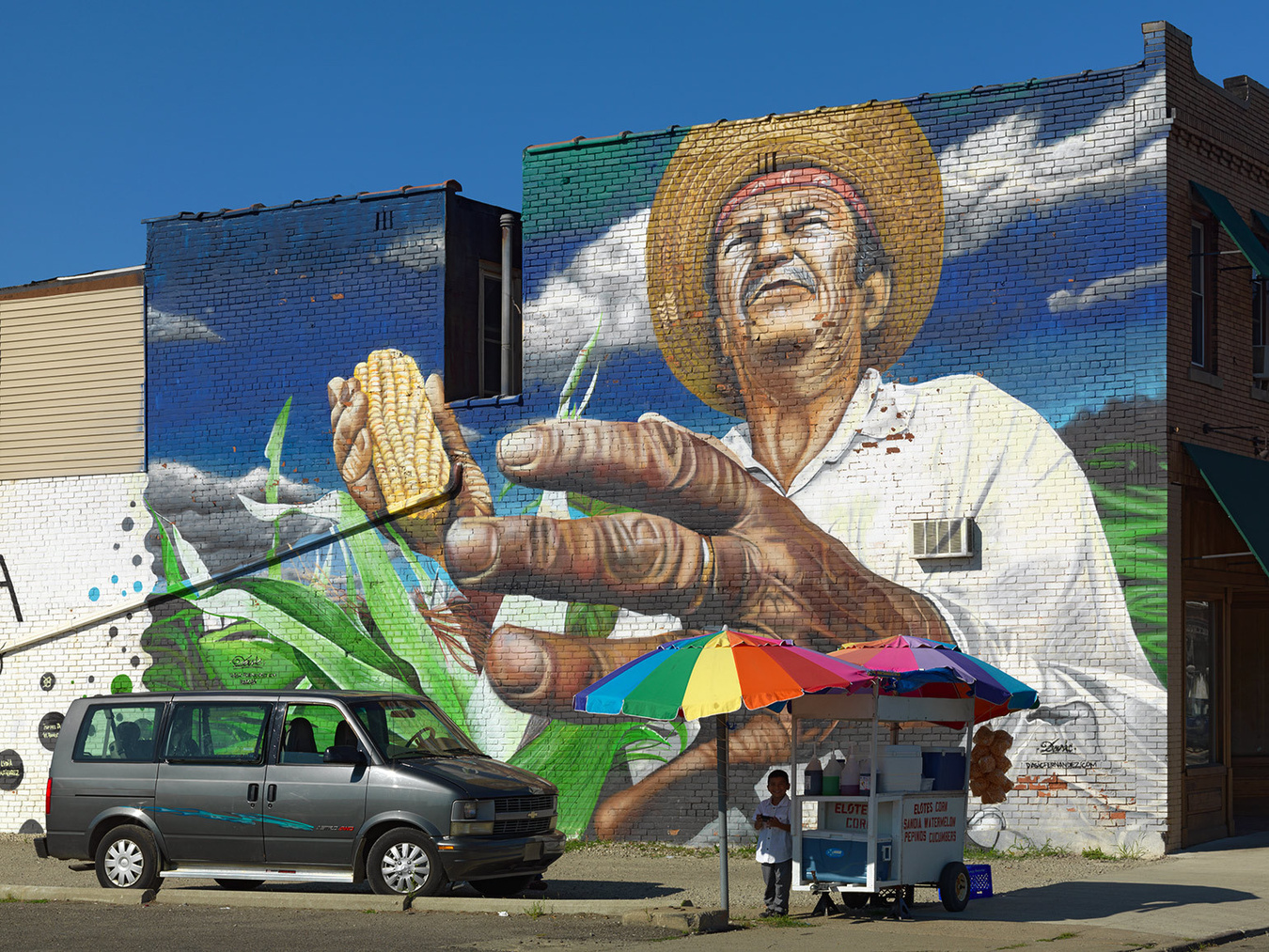 Street Vendor in Front of Large Wall Mural, Mexicantown, Detroit 2012